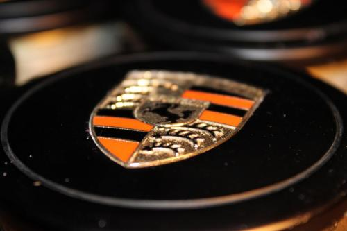 Fuch center caps with orange bar emblems.