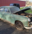 Two antique Mercedes Benz 4 door vehicles rescued from a barn.